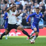 Chelsea Eden Hazard vies for the ball against Tottenham's Mousa Dembele
