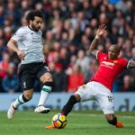 Mohamed Salah of Liverpool takes on Ashley Young of Manchester United