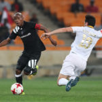 Roland Putsche tackles Thabo Matlaba for the ball