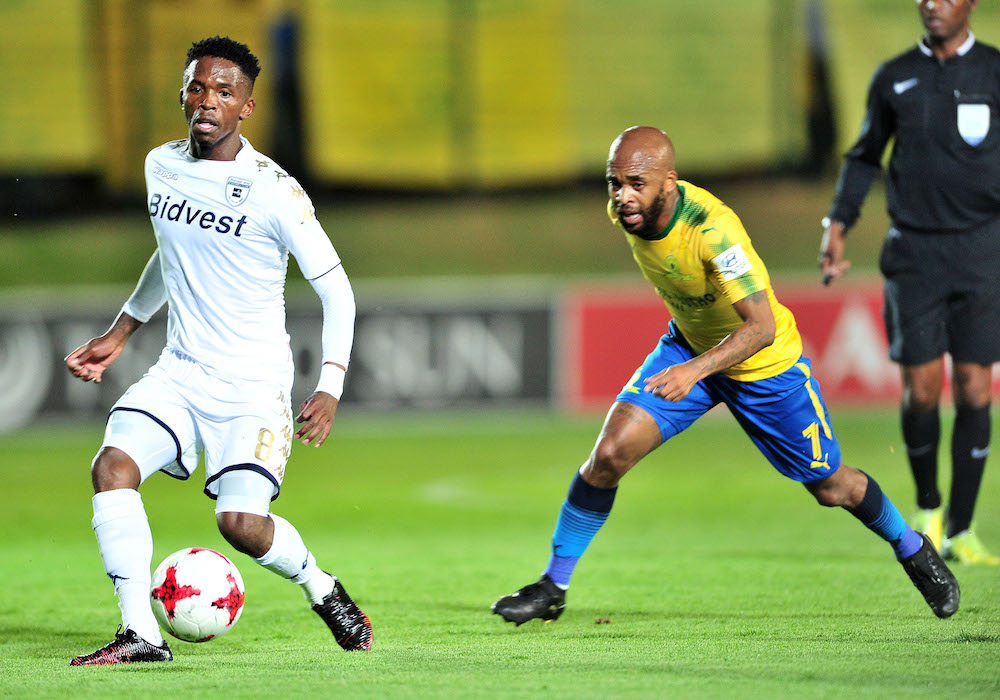 Thabang Monare challenged by Oupa Manyisa