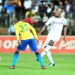 Sifiso Hlanti of Bidvest Wits challenged by Khama Billiat of Mamelodi Sundowns.