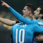Henrikh Mkhitaryan celebrates his goal with teammates