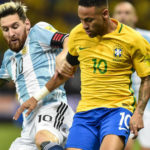 Lionel Messi battles Neymar for the ball