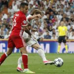 Bayern Munich's Thiago Alcantara fights for the ball with Luka Modric of Real Madrid.