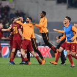 Roma's players celebrate after knocking out Barcelona.
