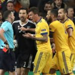 Referee Michael Oliver shows Juventus' goalkeeper Gianluigi Buffon the red card.