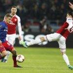 Fedor Chalov of CSKA Moscow in action against Hector Bellerin of Arsenal.