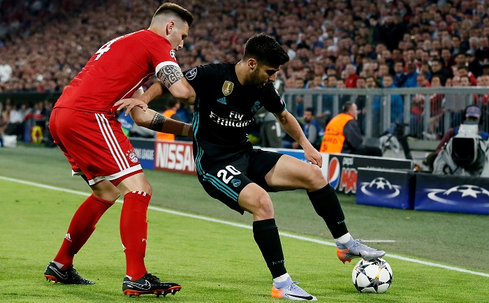 Bayern's Niklas Suele and Real Madrid's Marco Asensio.