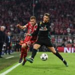 Bayern's Joshua Kimmich in action against Real Madrid's Cristiano Ronaldo.