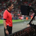 Match referee Deniz Aytekin consults the VAR system in an international friendly between England and Italy.