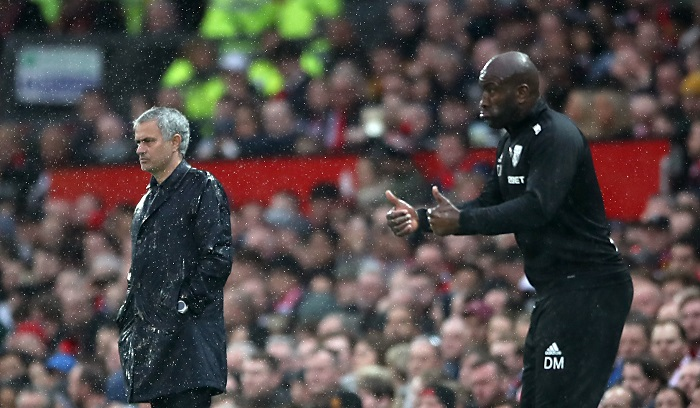 Manchester United manager Jose Mourinho and West Bromwich Albion Caretaker Manager Darren Moore.
