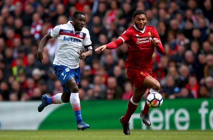 Stoke City's Mame Biram Diouf and Liverpool's Joe Gomez battle for the ball