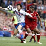 Stoke City's Ramadan Sobhi and Liverpool's Georginio Wijnaldum battle for the ball during the Premier League match at Anfield.