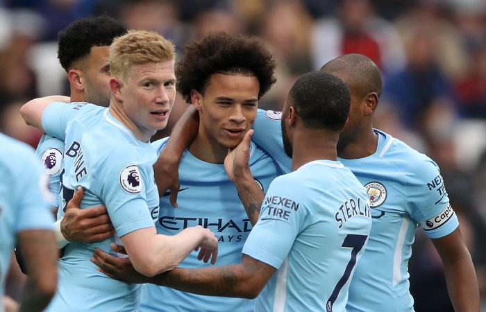 Manchester City celebrate scoring their first goal of the game.