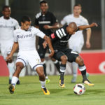 Thabo Qalinge challenged by Reeve Frosler