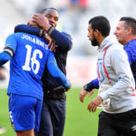 Benni McCarthy hugs his captain Robyn Johannes