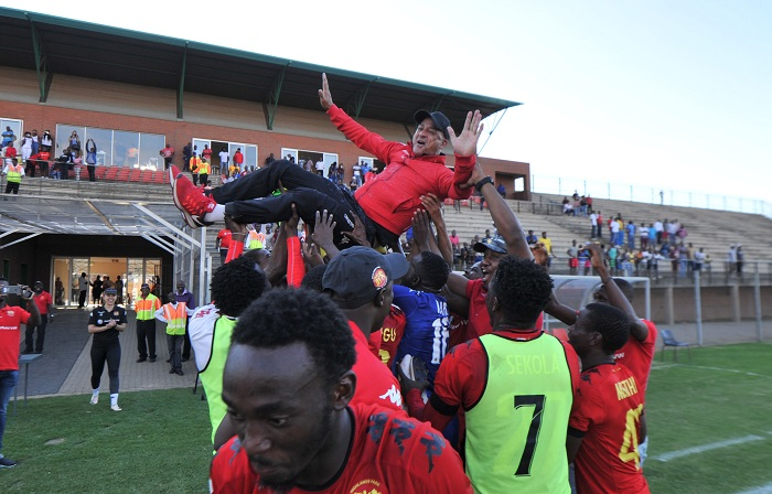 Owen Da Game coach of Highlands Park celebrates with the Team after securing the title.