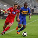 Dean Furman of Supersport United evades challenge from Thamsanqa Mkhize of Cape Town City.