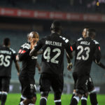 Augustine Mulenga celebrates his goal with teammates