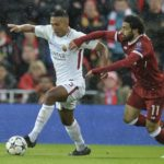 Roma's Juan Jesus and Liverpool's Mohamed Salah in action