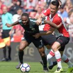 Maya Yoshida from Southampton vies for the ball against Manchester City winger Raheem Sterling.