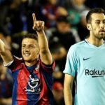 Barcelona midfielder Sergio Busquets looks on as Levante's Macedonian midfielder Enis Bardhi celebrates scoring.
