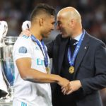 Real Madrid coach Zinedine Zidane and Casemiro with the Champions League trophy