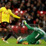 Watford's Abdoulaye Doucoure and Tottenham Hotspur goalkeeper Hugo Lloris battle for the ball
