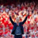 Arsenal manager Arsene Wenger salues the fans.