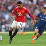 Manchester United's Chris Smalling and Eden Hazard of Chelsea battle for the ball.