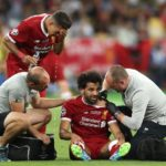 Liverpool's Mohamed Salah reacts after picking up an injury during the UEFA Champions League Final.
