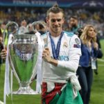 Real Madrid's Gareth Bale celebrates with the UCL trophy.