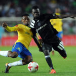 Bernard Morrison is challenged by Motjeka Madisha