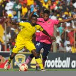 Tebogo Mabula of Jomo Cosmos is challenged by Phathutshedzo Nange of Black Leopards.
