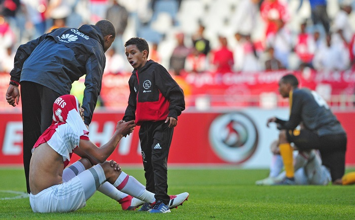 Tashreeq Morris of Ajax Cape Town is consoled by Ajax Cape Town ball boy after the game against Kaizer Chiefs.