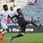Happy Jele of Orlando Pirates challenges Siphelele Mthembu of Free State Stars.