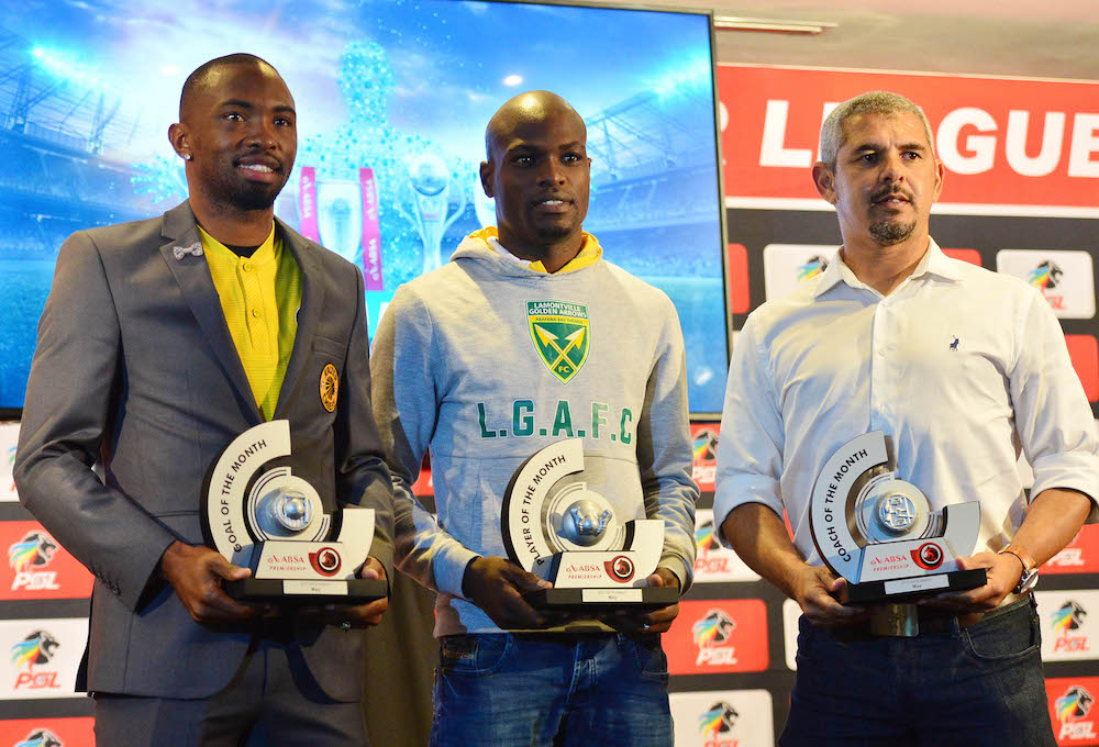 Bernard Parker, Lerato Lamola Clinton Larsen, coach of Golden Arrows with their awards.