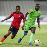 Tebogo Tlolane challenges Wangu Gome for the ball