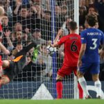 Jonas Lossl is beaten by Marcos Alonso's inadvertent header