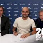 Pep Guardiola signing a contract extension at Manchester City