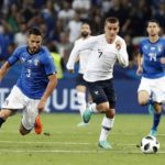 Antoine Griezmann of France in action against Danilo D'Ambrosio of Italy.