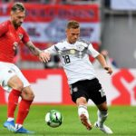 Austria's Peter Zulj in action against Joshua Kimmich of Germany.