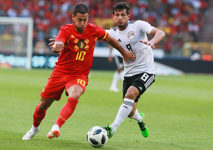 Eden Hazard of Belgium and Kahbaba of Egypt fight for the ball.