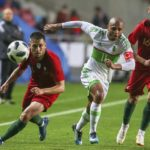 Algeria's Yacine Brahimi in action against Portugal players Raphael Guerreiro and Bruno Fernandes.