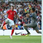 Keylor Navas of Costa Rica saves at close range to deny Jamie Vardy of England.