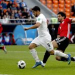 Luis Suarez of Uruguay and Ahmed Hegazy of Egypt
