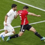 Luis Suarez of Uruguay in action against Sam Morsy of Egypt.