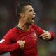 Cristiano Ronaldo of Portugal celebrates after scoring his third goal in the World Cup game against Spain.
