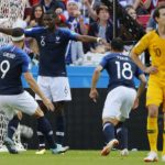 Paul Pogba of France celebrates with team mates after scoring his sides winner against Australia.
