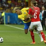 Neymar of Brazil and Michael Lang of Switzerland.